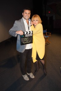 "Filmmaker John Hampian gets a squeeze from Ann-Margret as he collects the Best Narrative Short Film Award for ""Winter Light"""